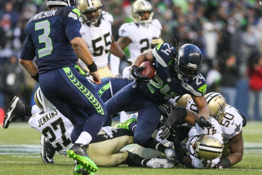 Seattle Seahawks player Marshawn Lynch plows through New Orleans Saints defenders during the second half of an NFC Divisional Playoff game on Saturday, January 11, 2014 at CenturyLink Field in Seattle. Photo: JOSHUA TRUJILLO, SEATTLEPI.COM