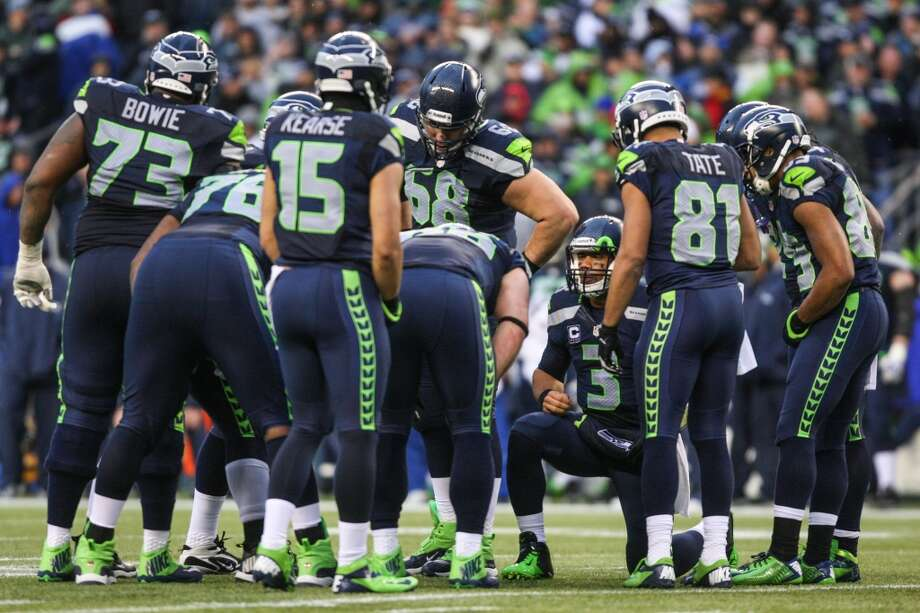 Seattle Seahawks listen to quarterback Russell Wilson during the huddle as they play the New Orleans Saints on Saturday, January 11, 2014 at CenturyLink Field in Seattle. Photo: JOSHUA TRUJILLO, SEATTLEPI.COM