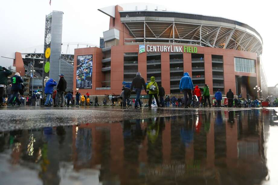 Puddles form from pouring rain at CenturyLink Field during the NFC Divisional Playoff game on Saturday, January 11, 2014. Photo: JOSHUA TRUJILLO, SEATTLEPI.COM