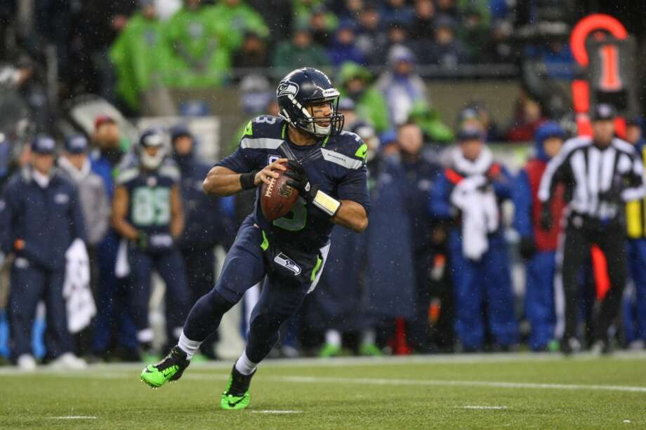 Seattle Seahawks quarterback Russell Wilson prepares to throw against the New Orleans Saints during the second half of an NFC Divisional Playoff game on Saturday, January 11, 2014 at CenturyLink Field in Seattle. Photo: JOSHUA TRUJILLO, SEATTLEPI.COM