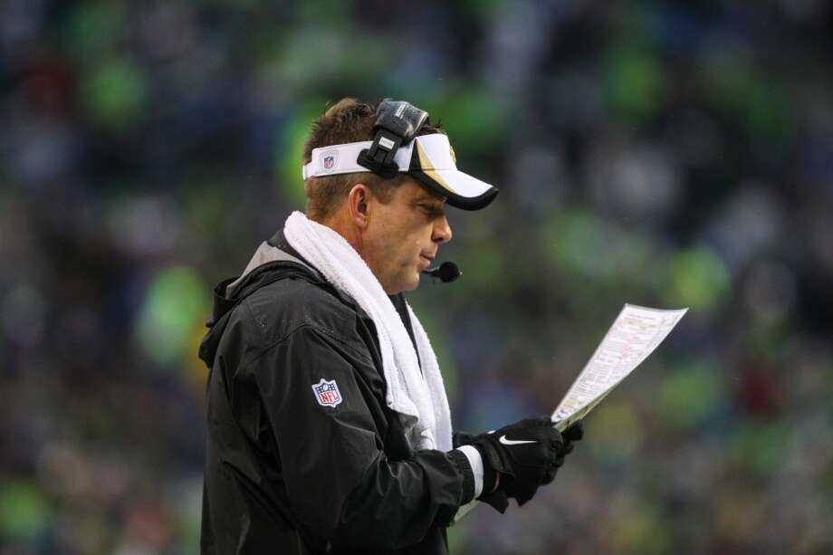 New Orleans Saints coach Sean Payton goes over plays during the second half of an NFC Divisional Playoff game on Saturday, January 11, 2014 at CenturyLink Field in Seattle. Photo: JOSHUA TRUJILLO, SEATTLEPI.COM