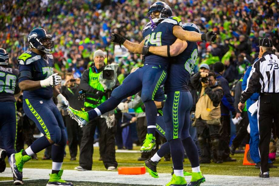 Seahawks running back Marshawn Lynch, center, is lifted off the ground following a second touchdown for his team during the second half of a playoff game against the New Orleans Saints Saturday, Jan. 11, 2014, at CenturyLink Field in Seattle. The Seahawks beat the Saints 23-15 and will advance to the second game of the playoffs. Photo: JORDAN STEAD, SEATTLEPI.COM