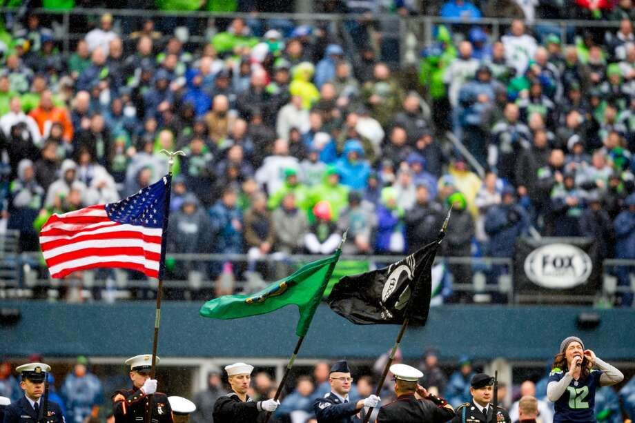 Singer-songwriter Brandi Carlile, lower right, performs the National Anthem before the first half of a playoff game against the New Orleans Saints Saturday, Jan. 11, 2014, at CenturyLink Field in Seattle. Photo: JORDAN STEAD, SEATTLEPI.COM