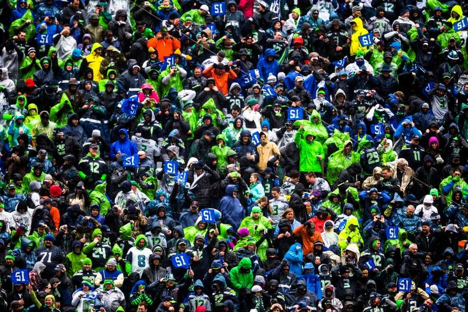 Seahawks fans decked out in Gore-Tex and ponchos await the beginning of a playoff game against the New Orleans Saints Saturday, Jan. 11, 2014, at CenturyLink Field in Seattle. The Seahawks led the Saints 16-0 at the half. Photo: JORDAN STEAD, SEATTLEPI.COM