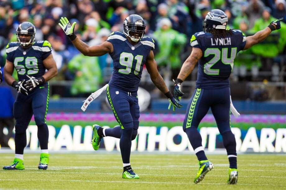 Seahawks Chris Clemons, center, and Marshawn Lynch, right, celebrate following a play during the first half of a playoff game Saturday, Jan. 11, 2014, at CenturyLink Field in Seattle. The Seahawks led the Saints 16-0 at the half. Photo: JORDAN STEAD, SEATTLEPI.COM