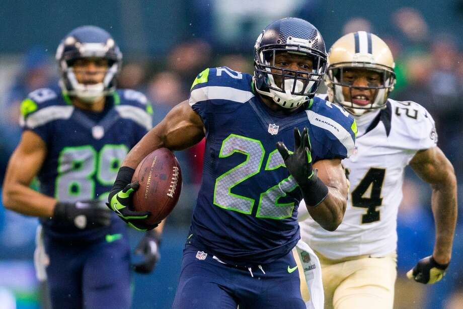 Robert Turbin, center, makes a break downfield during the first half of a playoff game Saturday, Jan. 11, 2014, at CenturyLink Field in Seattle. The Seahawks led the Saints 16-0 at the half. Photo: JORDAN STEAD, SEATTLEPI.COM