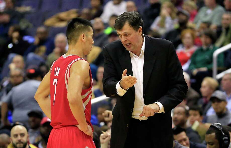 Rockets coach Kevin McHale, right, says Jeremy Lin provides leadership and spark coming off the bench. Photo: Rob Carr, Staff / 2014 Getty Images