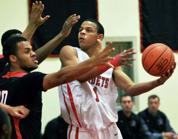 Albany Academy's # 1 Ray Jerome, at right, during Saturday's game against Long Island Lutheran Jan.