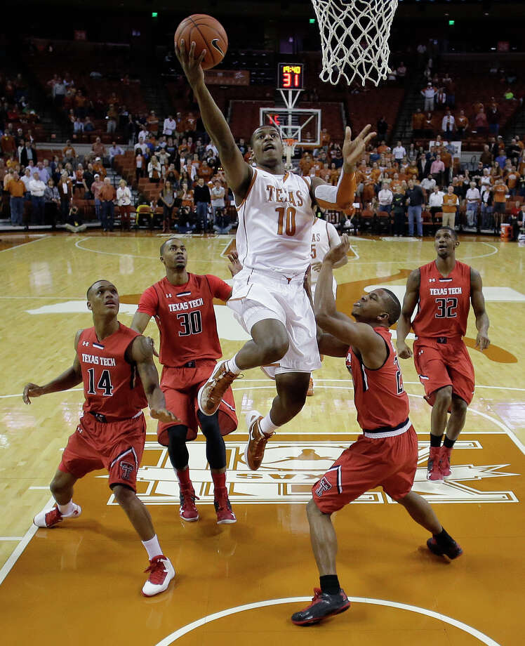 Jonathan Holmes (10) and the Longhorns made big plays down the stretch in Saturday's win. Photo: Eric Gay, STF / AP