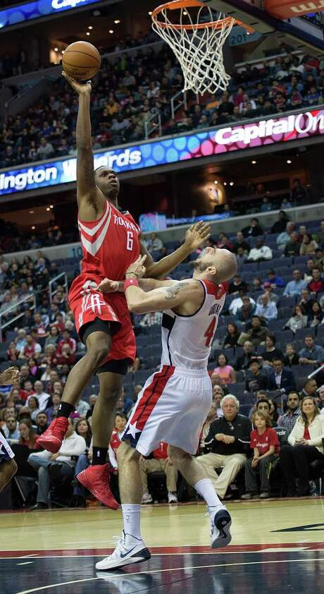Rockets power forward Terrence Jones, left, goes up and over Wizards center Marcin Gortat in the first half of Saturday night's game. Jones finished with 19 points, including 17 in the second half, and contributed a career-high 17 rebounds. Photo: Harry E. Walker / McClatchy-Tribune Photo Service