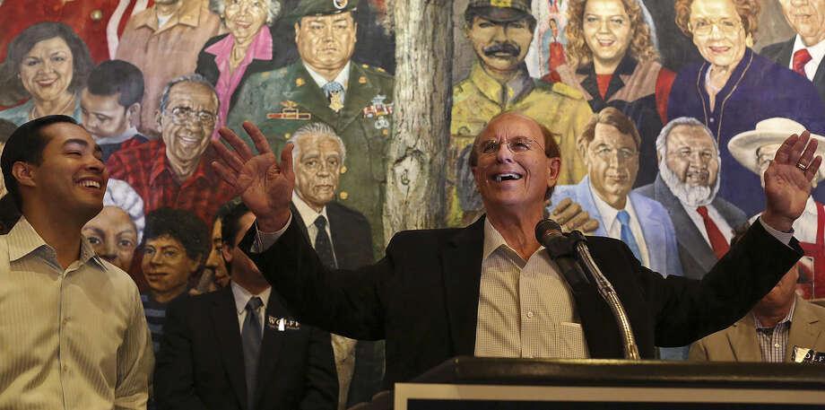 Bexar County Judge Nelson Wolff, Mayor Julián Castro at his side, officially kicks off his re-election campaign at Mi Tierra Café. Photo: Lisa Krantz / San Antonio Express-News / San Antonio Express-News