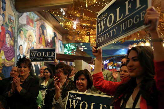 Supporters watch as Bexar County Judge Nelson Wolff officially kicks off his re-election campaign at Mi Tierra Cafe in San Antonio on Saturday, Jan. 11, 2014. Photo: San Antonio Express-News / San Antonio Express-News