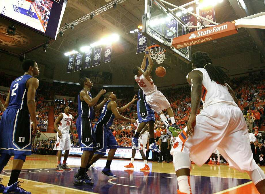 CLEMSON, SC - JANUARY 11: K.J. McDaniels #32 of the Clemson Tigers makes a slam dunk during the game against the Duke Blue Devils at Littlejohn Coliseum on January 11, 2014 in Clemson, South Carolina. The Clemson Tigers defeated the Duke Blue Devils by a score of 72-59. (Photo by Tyler Smith/Getty Images) ORG XMIT: 461954057 Photo: Tyler Smith / 2014 Getty Images