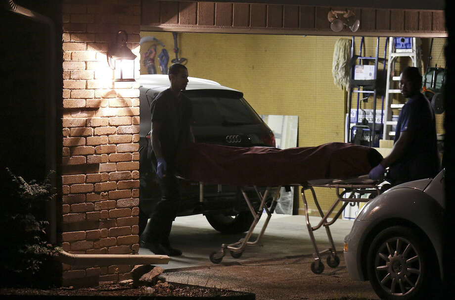 One of two bodies found at a home in the 13400 block of Vista Del Mar on the North Side is removed Saturday. Police said one of the men was in his 20s and the other was in his 40s. Photo: Edward A. Ornelas / San Antonio Express-News / © 2014 San Antonio Express-News