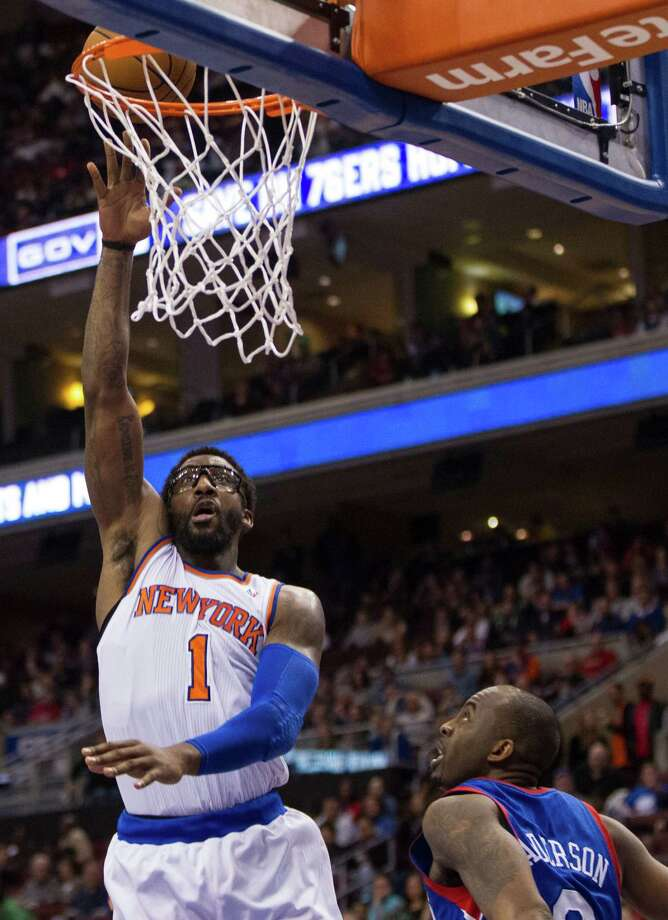 New York Knicks' Amar'e Stoudemire puts up the shot with Philadelphia 76ers' James Anderson guarding during the second half of an NBA basketball game, Saturday, Jan. 11, 2014, in Philadelphia.  The Knicks win 102-92.  (AP Photo/Chris Szagola) ORG XMIT: PACS110 Photo: Chris Szagola / FR170982 AP