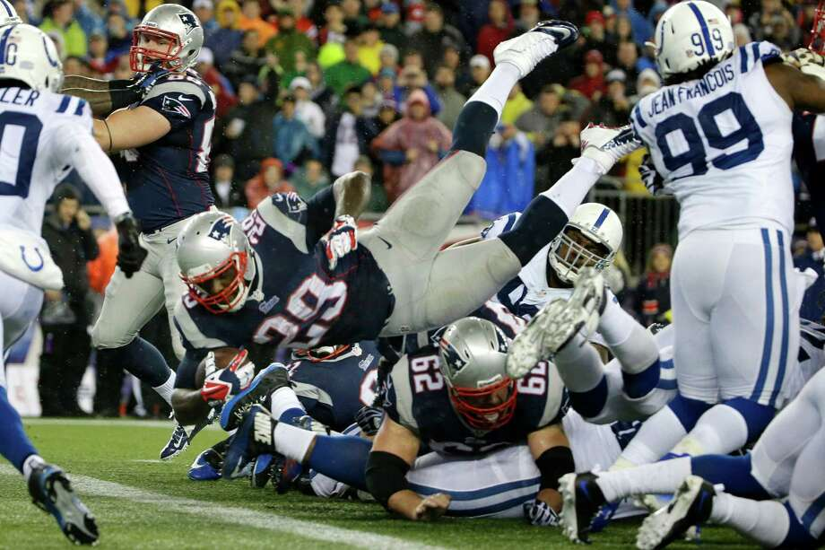 New England Patriots running back LeGarrette Blount (29) dives into the end zone for a touchdown during the first half of an AFC divisional NFL playoff football game against the Indianapolis Colts in Foxborough, Mass., Saturday, Jan. 11, 2014. (AP Photo/Matt Slocum) ORG XMIT: FBO121 Photo: Matt Slocum / AP