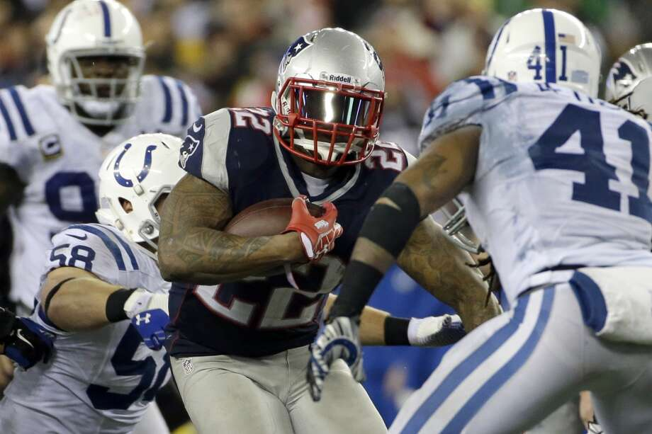 Patriots running back Stevan Ridley (22) carries the ball between Colts linebacker Andy Studebaker (58) and safety Antoine Bethea (41). Photo: Matt Slocum, Associated Press
