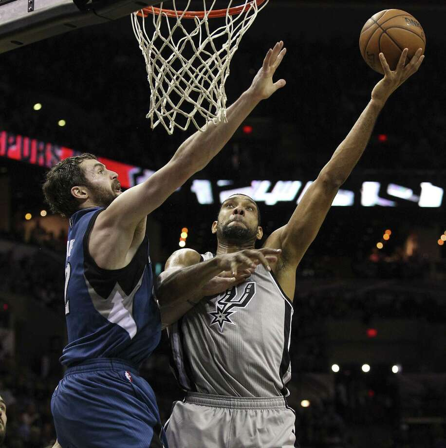 Tim Duncan (right) and the Spurs had their hands full with Kevin Love when the Timberwolves visited the AT&T Center on Dec. 13, but they won the game. Photo: Kin Man Hui / San Antonio Express-News / ©2013 San Antonio Express-News