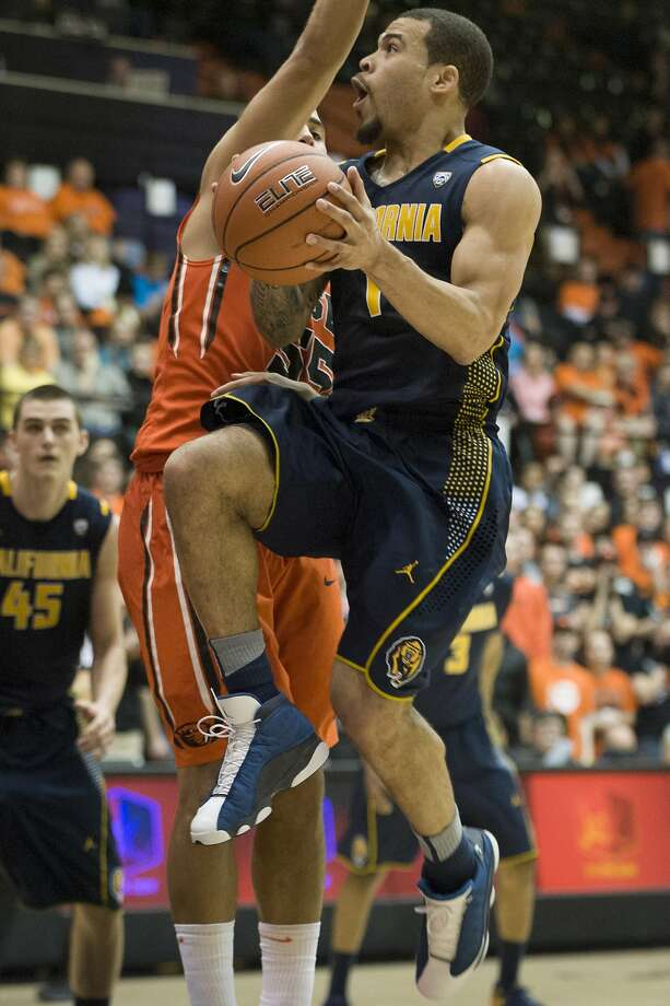 Justin Cobbs tries to evade Oregon State's Roberto Nelson for the shot on a night he had 20 points and nine assists for Cal. Photo: Karl Massdam, Associated Press
