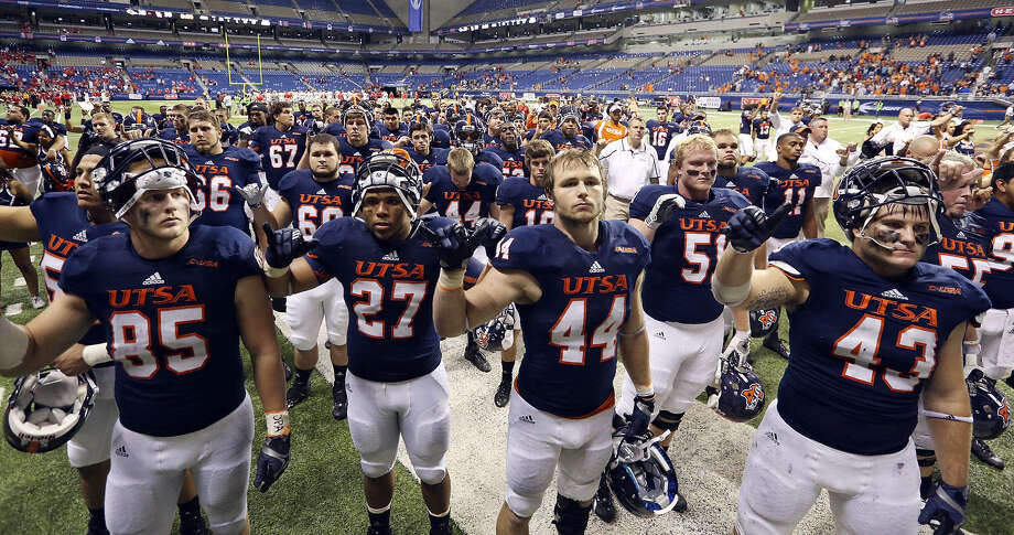 The UTSA football team's success and rapid rise into Conference USA has been due in large part to students paying a mandatory athletics fee that's tied with Texas State as the highest in the state among public schools at the Football Bowl Subdivision level. Photo: Edward A. Ornelas / San Antonio Express-News / © 2012 San Antonio Express-News