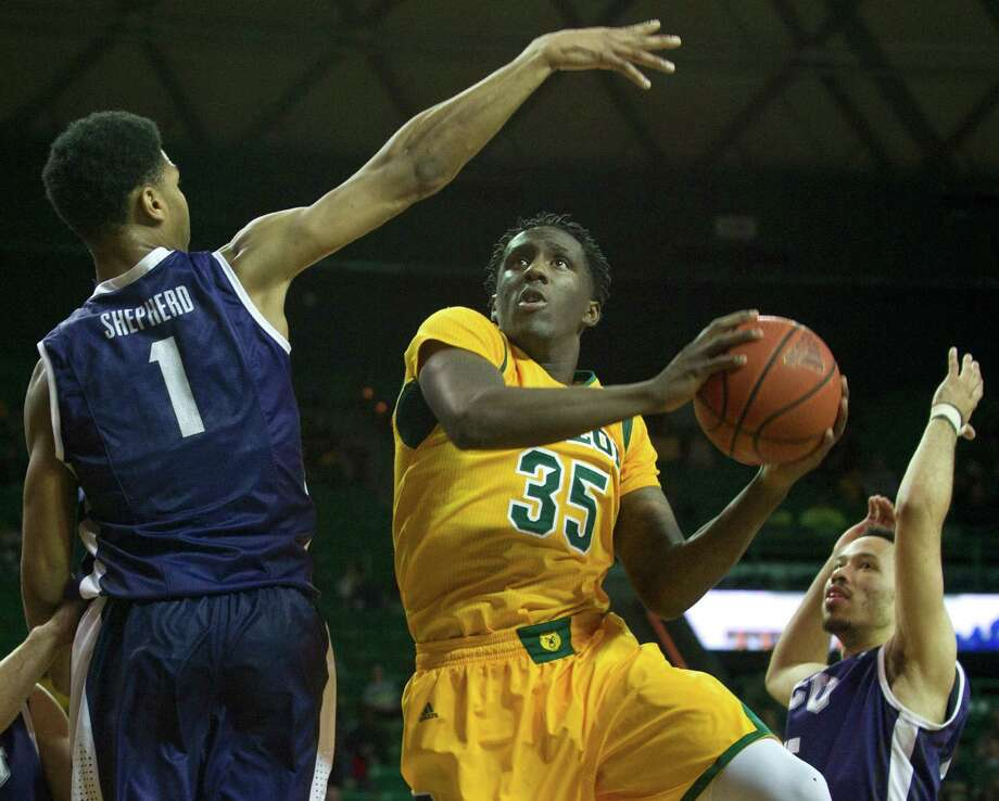 Baylor forward Taurean Prince, a sophomore from Warren High, drives to the basket looking to score some of his career-best 23 points against TCU. Photo: Cooper Neill / Getty Images / 2014 Getty Images
