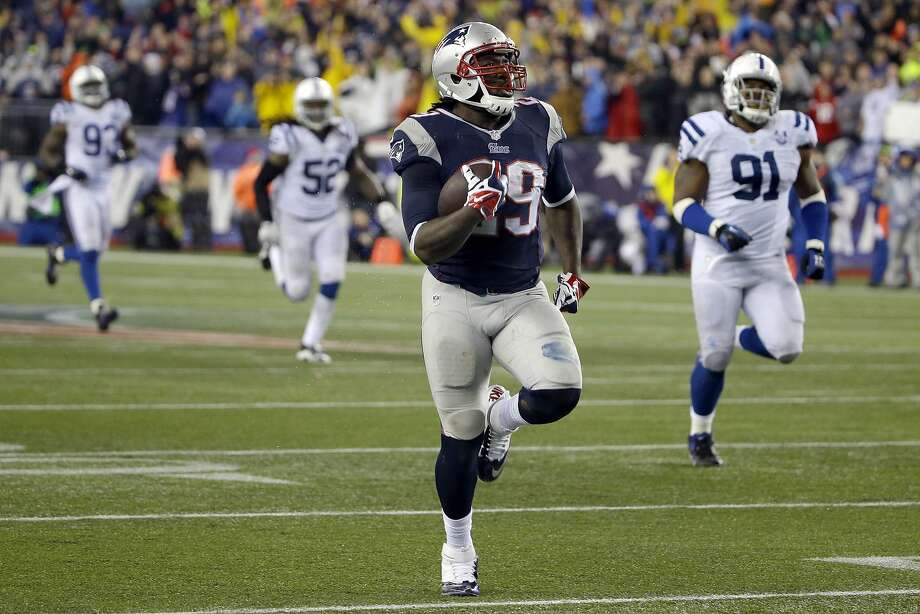 Patriots running back LeGarrette Blount runs 73 yards for a touchdown, his fourth of the day, in the fourth quarter. Photo: Matt Slocum, Associated Press
