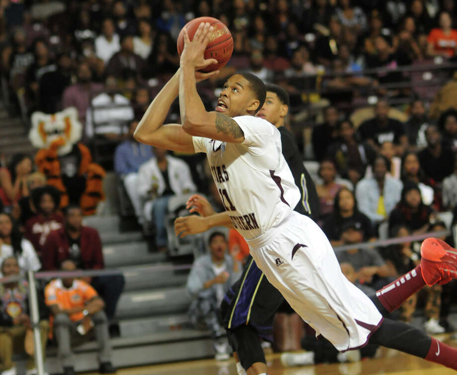 Texas Southern's Lawrence Johnson-Danner took an unconventional path to the basket in Saturday night's triple-overtime win over Prairie View A&M. Photo: Jerry Baker, Freelance