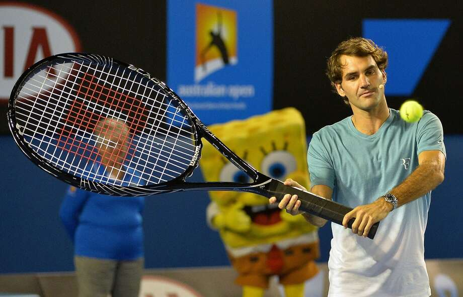 Try to pass me now, Djokovic!Roger Federer switches to a new racket at the Australian Open in Melbourne. Photo: Paul Crock, AFP/Getty Images