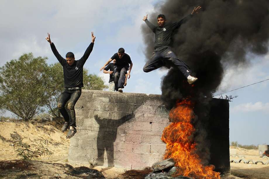 TOPSHOTS Palestinian students take part in a training session organised by Hamas national security in the southern Gaza Strip town of Rafah on January 11, 2014.  AFP PHOTO/SAID KHATIBSAID KHATIB/AFP/Getty Images Photo: Said Khatib, AFP/Getty Images