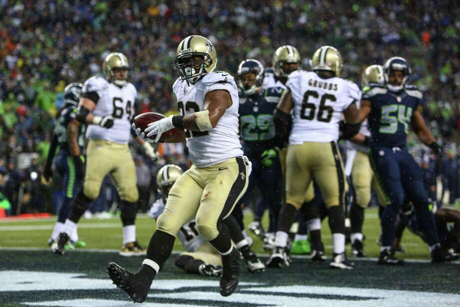 New Orleans Saints player Mark Ingram runs the ball into the end zone for a two point conversion during the second half of an NFC Divisional Playoff game on Saturday, January 11, 2014 at CenturyLink Field in Seattle. Photo: JOSHUA TRUJILLO, SEATTLEPI.COM / SEATTLEPI.COM