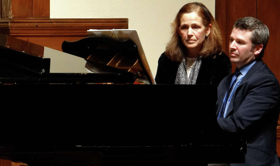"With Misty Beyer assisting, Rev. Alan Murchie plays Brahms' Sonata for Two Pianos, Op. 34b, at Pequot Library's ""An Evening of Music"" fundraiser Saturday night. Photo: Mike Lauterborn / Fairfield Citizen contributed"
