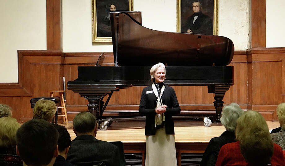 "Martha Lord, the Pequot Library's executive director, welcomes the audience Saturday to the library's ""An Evening of Music."" Photo: Mike Lauterborn / Fairfield Citizen contributed"