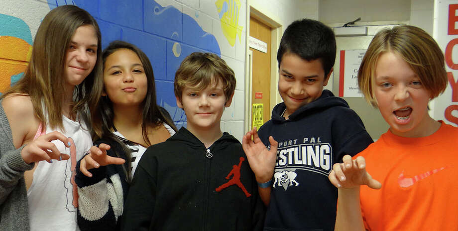Sarah Ginsberg, 11; essica Dell'isola, 11; Alex Dowd, 11; Adam Echevarria, 12, and Emerson Anvari, 12, strike a pose at Westport Weston Family Y's Teen Night on Friday. Photo: Mike Lauterborn / Westport News contributed