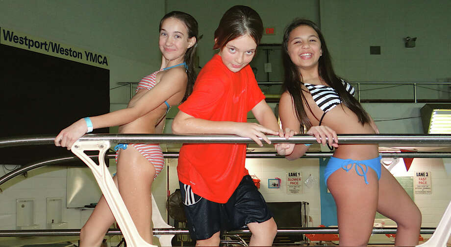 Aly Sivinski, 11; Jessica Dell'isola, 11, and Emerson Anvari, 12, at the pool Friday during the Westport Weston Family Y's Teen Night. Photo: Mike Lauterborn / Westport News contributed
