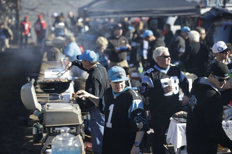 Fans prepare a pre-game meal before the first half of a divisional playoff NFL football game between the Carolina Panthers and the San Francisco 49ers, Sunday, Jan. 12, 2014, in Charlotte, N.C. (AP Photo/Gerry Broome) Photo: Associated Press