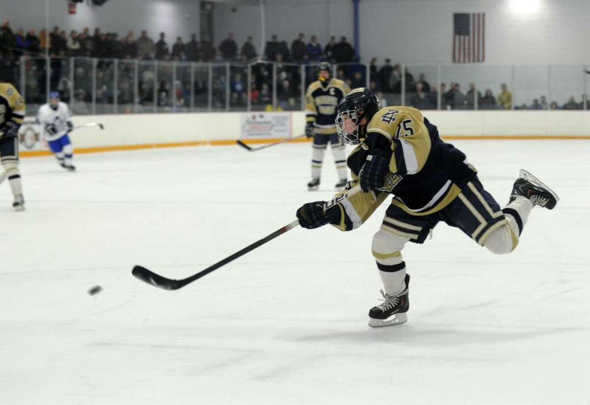 Notre Dame's Charlie Zuccarini hits a shot towards the goal, during hockey action against West Haven in West Haven, Conn. on Wednesday Feb. 03, 2010.