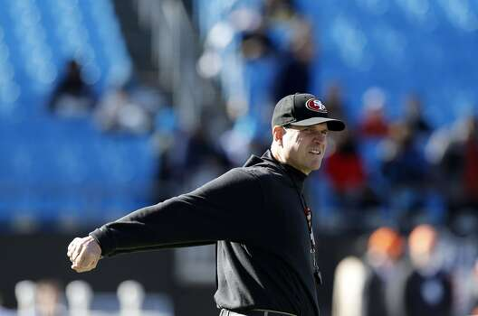 49ers head coach Jim Harbaugh stays loose before the start of the game, as the San Francisco 49ers prepare to take on the Carolina Panthers in the NFC divisional playoffs in Charlotte, North Carolina on Sunday Jan. 12, 2014, at Bank of America stadium. Photo: Michael Macor, The Chronicle