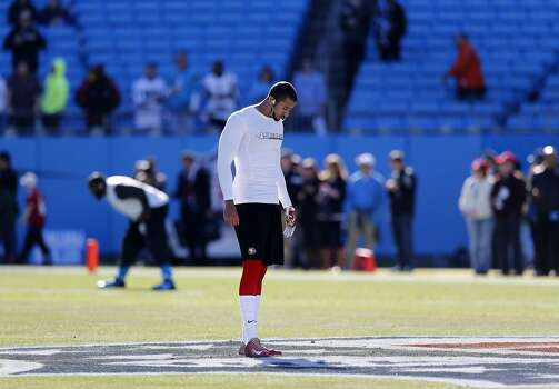 49er quarterback Colin Kaepernick,(7) during warm ups before the start of the game, as the San Francisco 49ers prepare to take on the Carolina Panthers in the NFC divisional playoffs in Charlotte, North Carolina on Sunday Jan. 12, 2014, at Bank of America stadium. Photo: Michael Macor, The Chronicle