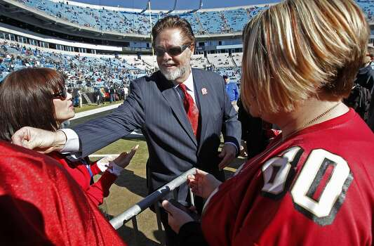 49ers owner, John York, passes out pins to fans before the game, as the San Francisco 49ers prepare to take on the Carolina Panthers in the NFC divisional playoffs in Charlotte, North Carolina on Sunday Jan. 12, 2014, at Bank of America stadium. Photo: Michael Macor, The Chronicle