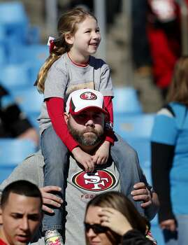 Danny Morgan and his daugher Brianna watched the 49ers warm up. They traveled from Ohio to root for their team Sunday January 12, 2014. The San Francisco 49ers take on the Carolina Panthers in a divisional playoff game at Bank of America stadium in Charlotte, North Carolina. Photo: Brant Ward, The Chronicle