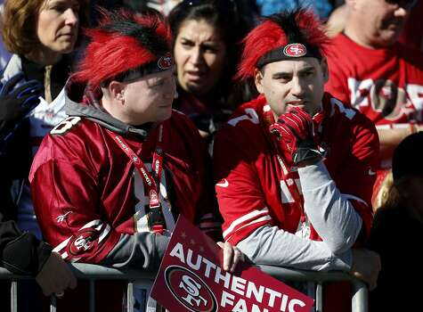 Two fans, Tony Langley (right) and his friend Ronnie watched the 49ers warm up Sunday January 12, 2014. The San Francisco 49ers take on the Carolina Panthers in a divisional playoff game at Bank of America stadium in Charlotte, North Carolina. Photo: Brant Ward, The Chronicle