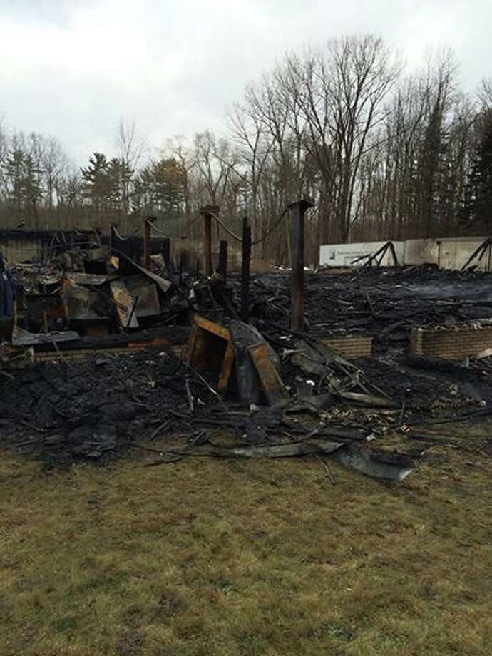 The remains of Burnt Hills Lanes bowling alley on Route 50 in Ballston Sunday, Jan. 12, 2014 after a fire gutted the building. (Photo by Lauren Stanforth)