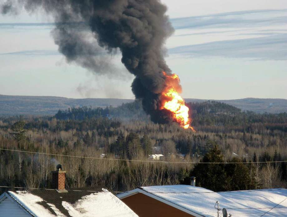 A large fireball rises from the site of a train derailment in New Brunswick, Canada,  Friday, Jan. 10, 2014, as officials used a controlled explosion to blast holes in three tanker cars. CN spokesman Jim Feeny says the procedure they used is known as vent and burn, and preliminary indications are that it went according to plan. Photo: KEVIN BISSETT, AP  / CP