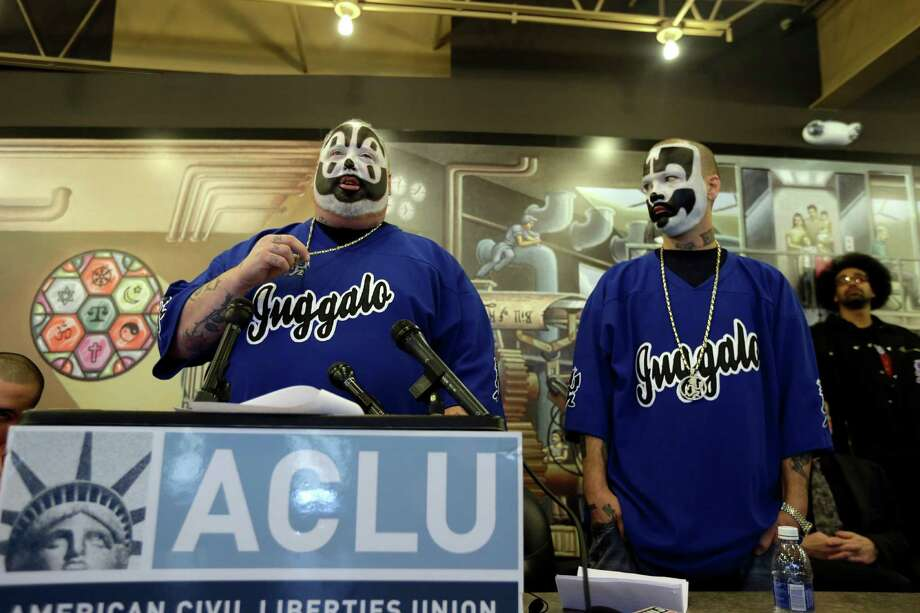 Joseph Bruce aka Violent J, left, and Joseph Utsler aka Shaggy 2 Dope, members of the Insane Clown Posse are seen after a news conference in Detroit, Wednesday, Jan. 8, 2014. The rap metal group sued the U.S. Justice Department on Wednesday over a 2011 FBI report that describes the duo's devoted fans, the Juggalos, as a dangerous gang, saying the designation has tarnished their fans' reputations and hurt business. The American Civil Liberties Union filed the lawsuit in Detroit federal court on behalf of the group's two members.From the Associated Press story:The