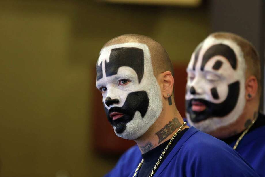 Joseph Utsler aka Shaggy 2 Dope, left, and Joseph Bruce aka Violent J, left, members of the Insane Clown Posse are seen during a news conference in Detroit, Wednesday, Jan. 8, 2014. The rap metal group sued the U.S. Justice Department on Wednesday over a 2011 FBI report that describes the duo's devoted fans, the Juggalos, as a dangerous gang, saying the designation has tarnished their fans' reputations and hurt business. The American Civil Liberties Union filed the lawsuit in Detroit federal court on behalf of the group's two members.From the Associated Press story:The American Civil Liberties Union filed the lawsuit in Detroit federal court on behalf of the group's two members, Joseph Bruce, or Violent J, and Joseph Utsler, or Shaggy 2 Dope. It also names four fans as plaintiffs.
