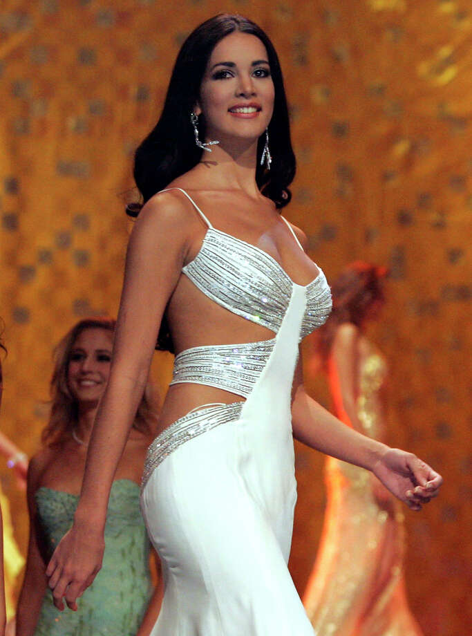 In this May 31, 2005 file photo, Monica Spear, Miss Venezuela 2005, competes at the Miss Universe competition in Bangkok, Thailand.  Venezuelan authorities say the soap-opera actress and former Miss Venezuela and her husband were shot and killed resisting a robbery after their car broke down. Prosecutors said in a statement that Monica Spear and Henry Thomas Berry were slain late Monday, Jan. 6, 2014 near Puerto Cabello, Venezuela's main port. Photo: Rungroj Yongrit, AP  / AP2005