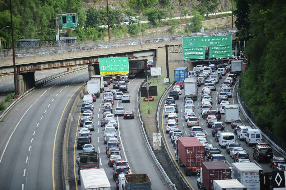 In this Aug. 15, 2013, file photo, heavy traffic builds on the approach to the George Washington Bridge in Leonia, N.J. after an automobile accident. Engineers can obtain data from actual traffic events to study without the need for artificially created congestion. Claiming that closing lanes to the George Washington Bridge in September 2013 was necessary to conduct a traffic study, the Port Authority of New York and New Jersey closed some of the lanes leading to the bridge: causing massive congestion to build in Fort Lee, N.J. Information made public in early January 2014 shows that the lane closures were likely politically motivated, rather than part of a scientific study.  (AP Photo/The Record, Marko Georgie, File)  Photo: Marko Georgiev, AP  / The Record