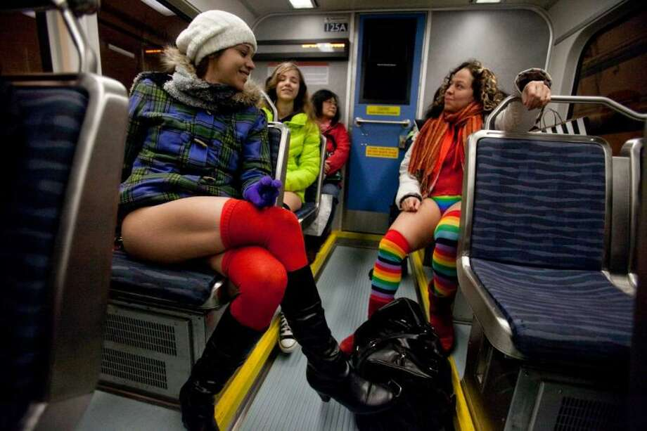 Venis Gonzalez, left, sits in her seat during Emerald City Improv's No Pants Light Rail Ride on Sunday, January 13, 2013. Dozens of participants took off their pants while riding on the train, shocking some other passengers. Photo: JOSHUA TRUJILLO/SEATTLEPI.COM