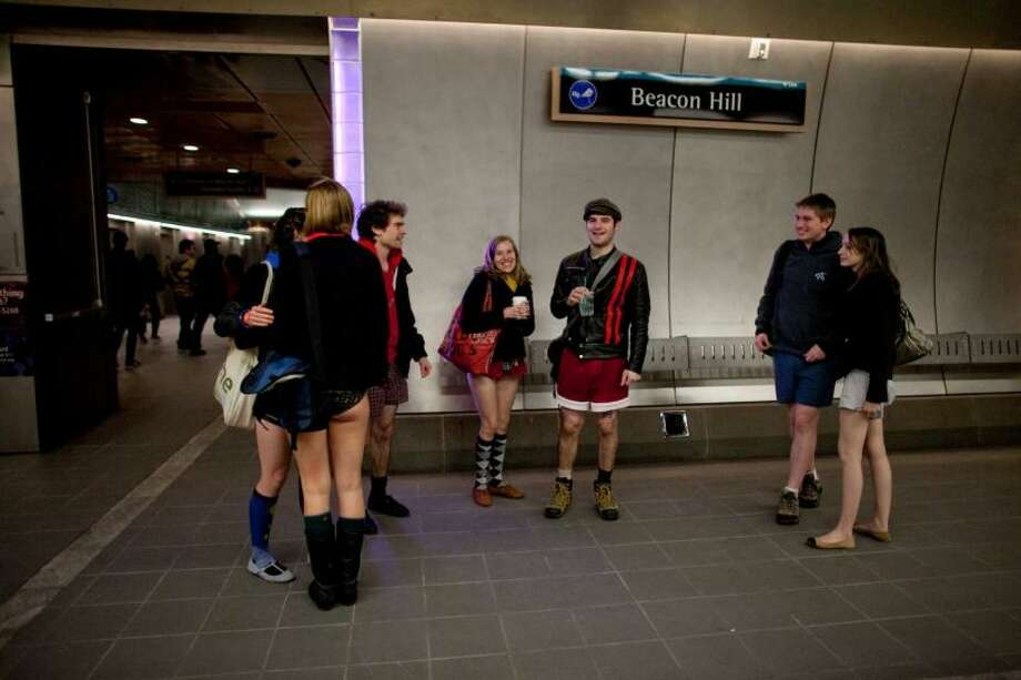 Participants gather at the Beacon Hill station during Emerald City Improv's No Pants Light Rail Ride on Sunday, January 13, 2013. Dozens of participants took off their pants while riding on the train, shocking some other passengers. Photo: JOSHUA TRUJILLO/SEATTLEPI.COM