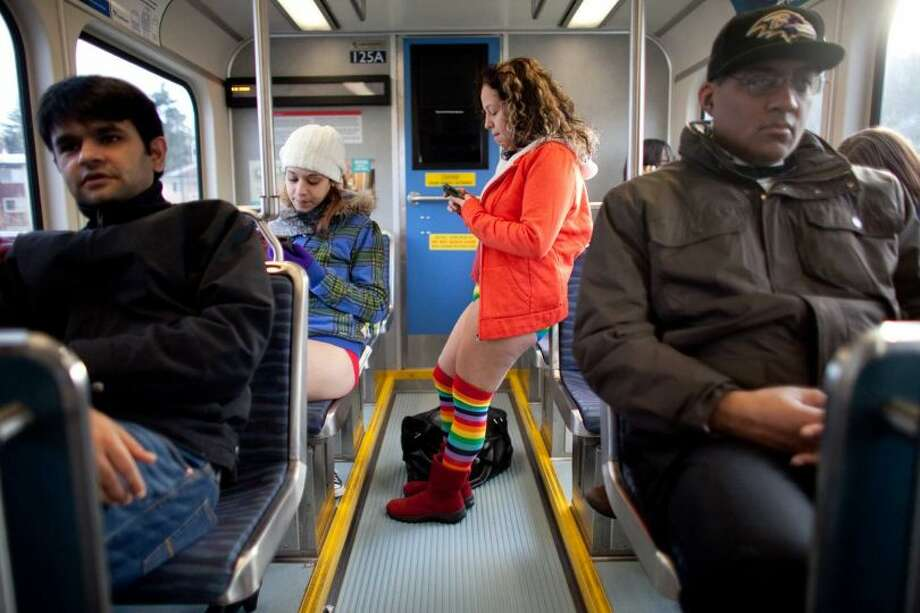 Participants ride the rail during Emerald City Improv's No Pants Light Rail Ride on Sunday, January 13, 2013. Dozens of participants took off their pants while riding on the train, shocking some other passengers. Photo: JOSHUA TRUJILLO/SEATTLEPI.COM